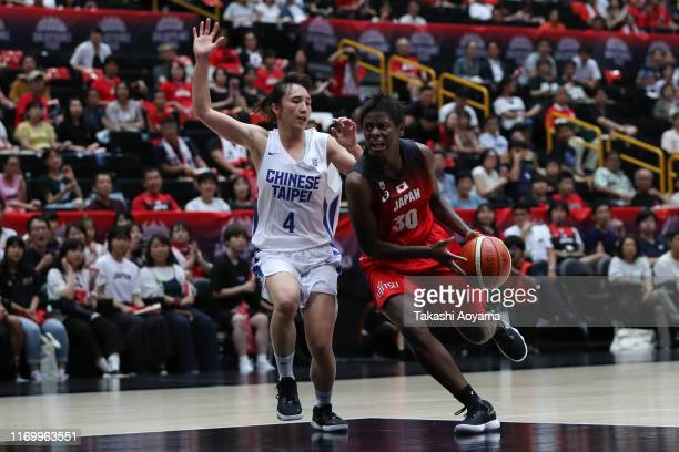 Evelyn Mawuli of Japan drives to the basket against Chia Wen Kuo of Chinese Taipei during the Game One of the women's basketball international game...