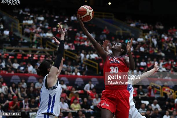 Evelyn Mawuli of Japan lays the ball up during the Game One of the women's basketball international game between Japan and Chinese Taipei at Saitama...