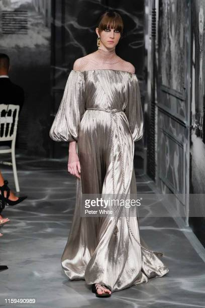 Evelyn Nagy walks the runway during the Christian Dior Haute Couture Fall/Winter 2019 2020 show as part of Paris Fashion Week on July 01, 2019 in...