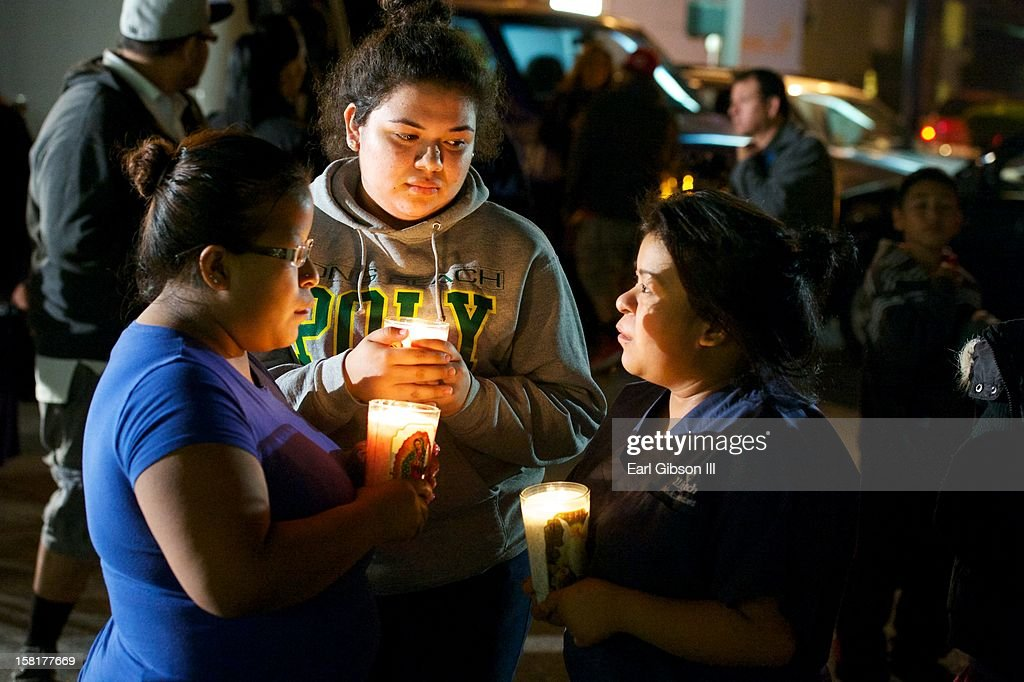 Evelyn Renteria (C) attends a candlelight vigil for singer Jenni Rivera on December 10, 2012 in Long Beach, California.