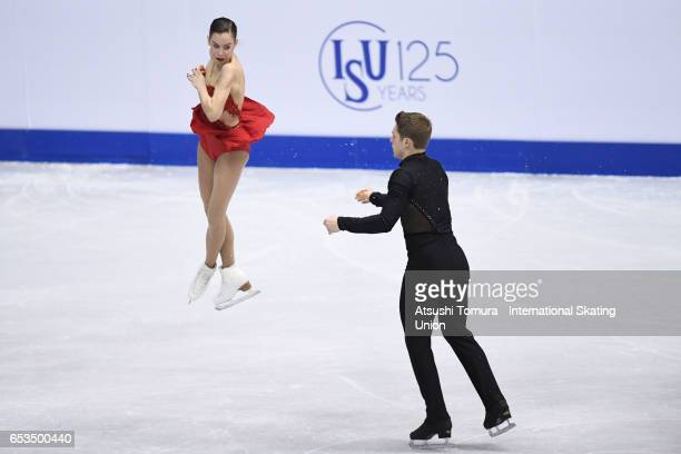 Evelyn Walsh and Trennt Michaud of Canada compete in the Junior Pairs Short Program during the 1st day of the World Junior Figure Skating...