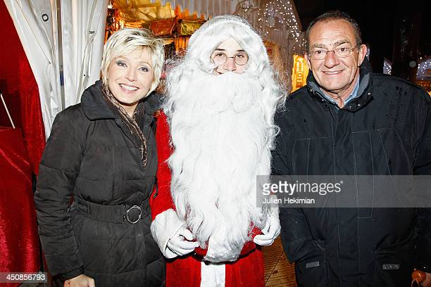Evelyne Dheliat and Jean Pierre Pernaut attend the launch of the Paris Christmas illuminations at the ChampsÉlysées on November 20 2013 in Paris...
