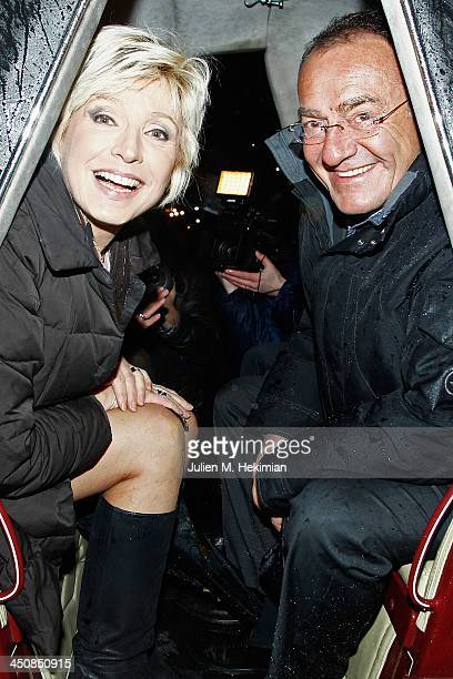 Evelyne Dheliat and Jean Pierre Pernaut seated in a carriage launch the Paris Christmas illuminations at the ChampsÉlysées on November 20 2013 in...