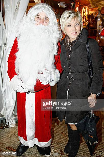 Evelyne Dheliat poses with Father Christmas at the launch of the the Paris Christmas illuminations at the launch the Paris Christmas illuminations at...