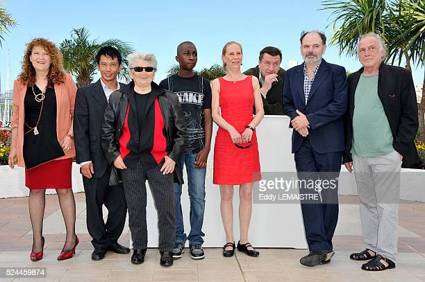 Evelyne Didi Quoc DungNguyen Little Bob Kati Outinen Aki Kaurismaki JeanPierre Darroussin and Blondin Miguel at the photo call for 'Le Havre' during...