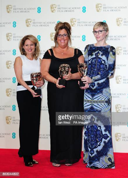 Evelyne Noraz Lori McCoyBell Kathrine Gordon with the award for Best Hair and Make Up for 'American Hustle' at The EE British Academy Film Awards...
