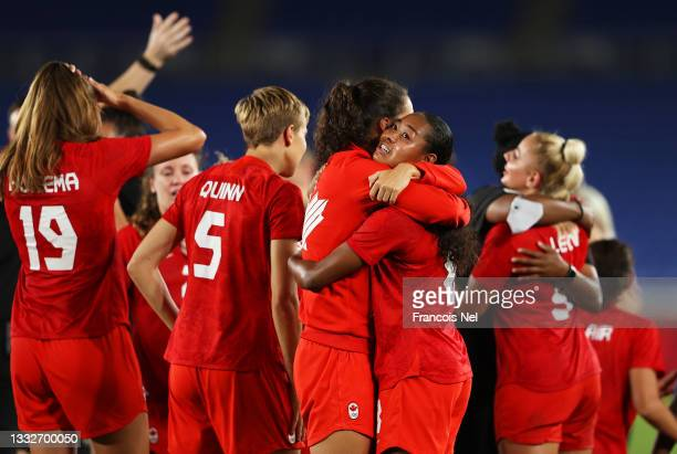Evelyne Viens and Jayde Riviere of Team Canada celebrate following their team's victory in the penalty shoot out after the Women's Gold Medal Match...