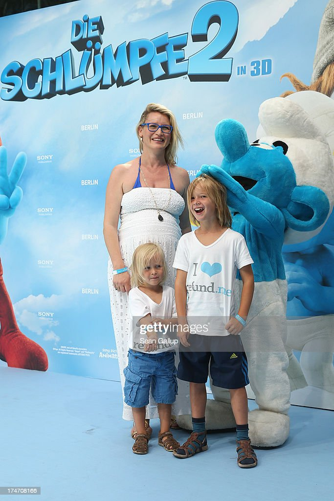 Eve-Maren Buechner with Children Jack and Max attend the 'Die Schluempfe 2' Germany Premiere at Sony Centre on July 28, 2013 in Berlin, Germany.