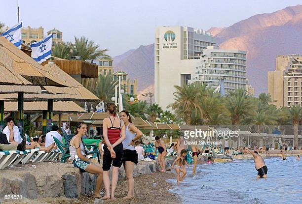 Even as evening draws near, tourists enjoy one of the many beaches in the southern Israeli city of Eilat May 4 beaches which in previous years were...