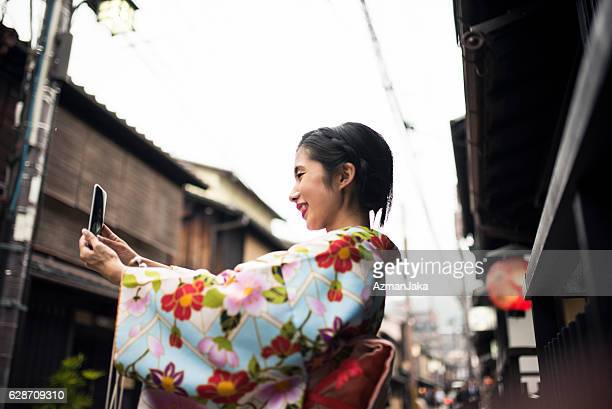 even geishas take selfies - desire stock pictures, royalty-free photos & images