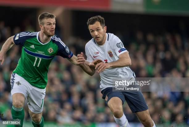 Even Hovland of Norway Chris Brunt of Northern Ireland during the FIFA 2018 World Cup Qualifier between Northern Ireland and Norway at Windsor Park...