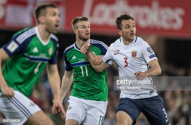 Even Hovland of Norway Gareth McLaughlin Chris Brunt og Northern Ireland during the FIFA 2018 World Cup Qualifier between Northern Ireland and Norway...