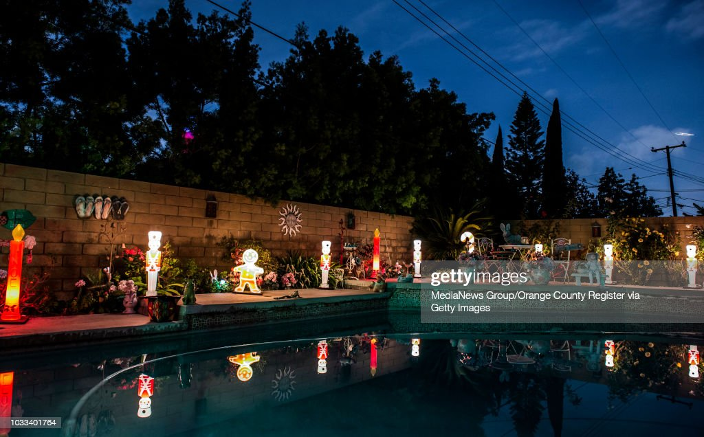 even the backyard pool at the braun home is surrounded by christmas decorations santabob