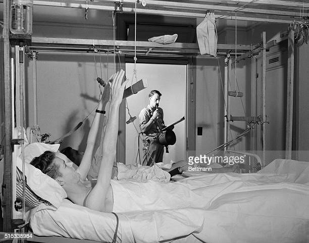 Even the bedridden get a series of calisthenics to speed their recovery from war wounds in the US Army's ream general hospital once known as the...