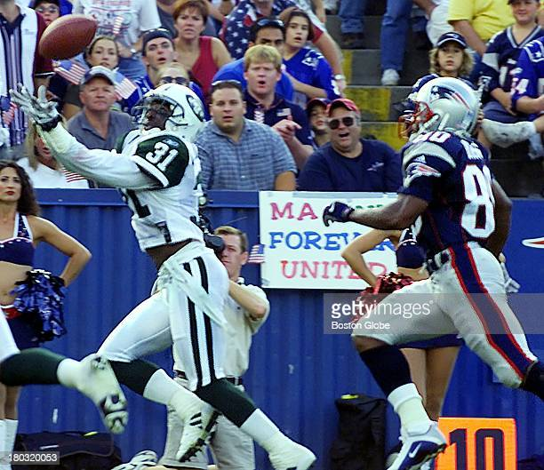 Even the fans know that Drew Bledsoe's pass intended for Troy Brown right is about to be intercepted by the Jets' Aaron Glenn