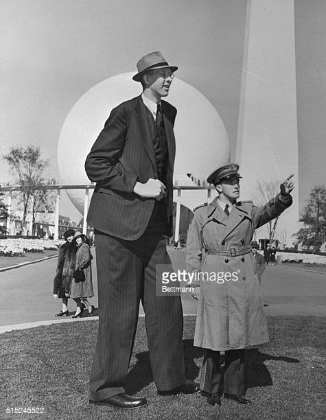 Even the perisphere background looks small as Robert Wadlow the world's tallest man who towers 8 feet 9 1/2 inches and weighs 491 pounds goes...