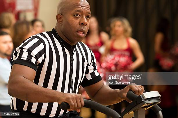 Even the referees warm up before the first half of the game between the Northeastern Huskies and the Boston University Terriers on November 18th at...