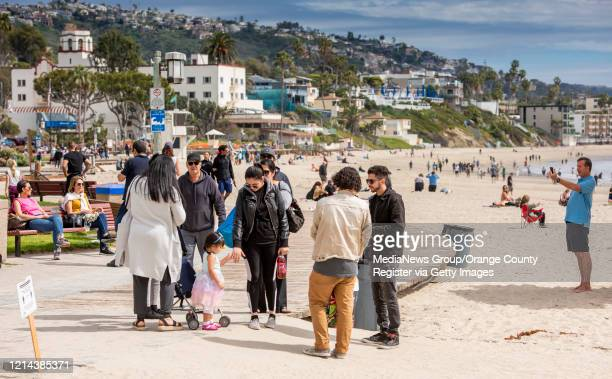Even though the beach at Main Beach in Laguna Beach on Sunday March 22 2020 was sparsely populated many people gathered on boardwalk and benches...