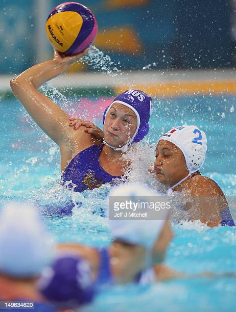 Evengiia Khokhriakova of Russia is tackled by Simona Abbate of Italy on Day 5 of the London 2012 Olympics at Water Polo Arena on August 1 2012 in...
