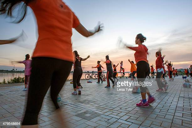 Evening aerobics on the riverfront in Vientiane Laos