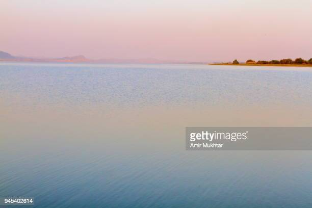 evening and dusk at lake - punjab pakistan stock pictures, royalty-free photos & images