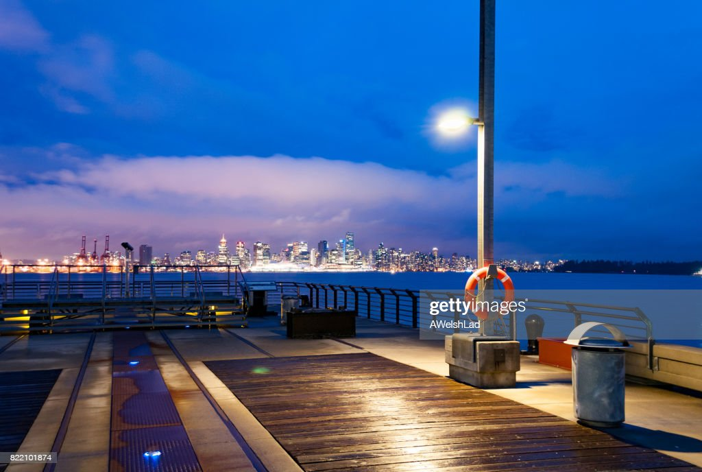 Evening at Burrard Dry Dock Pier with downtown Vancouver, BC evening : Stock Photo