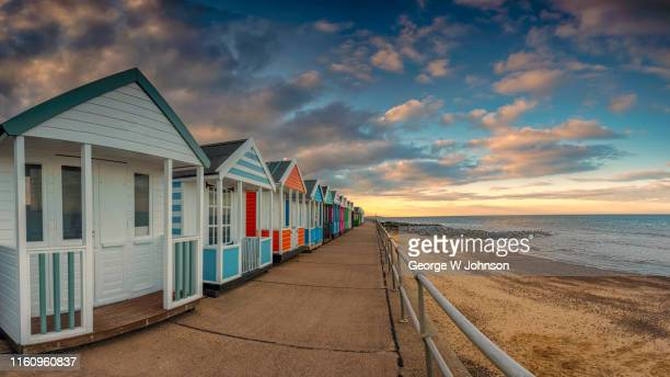 evening at the beach - beach hut stock pictures, royalty-free photos & images