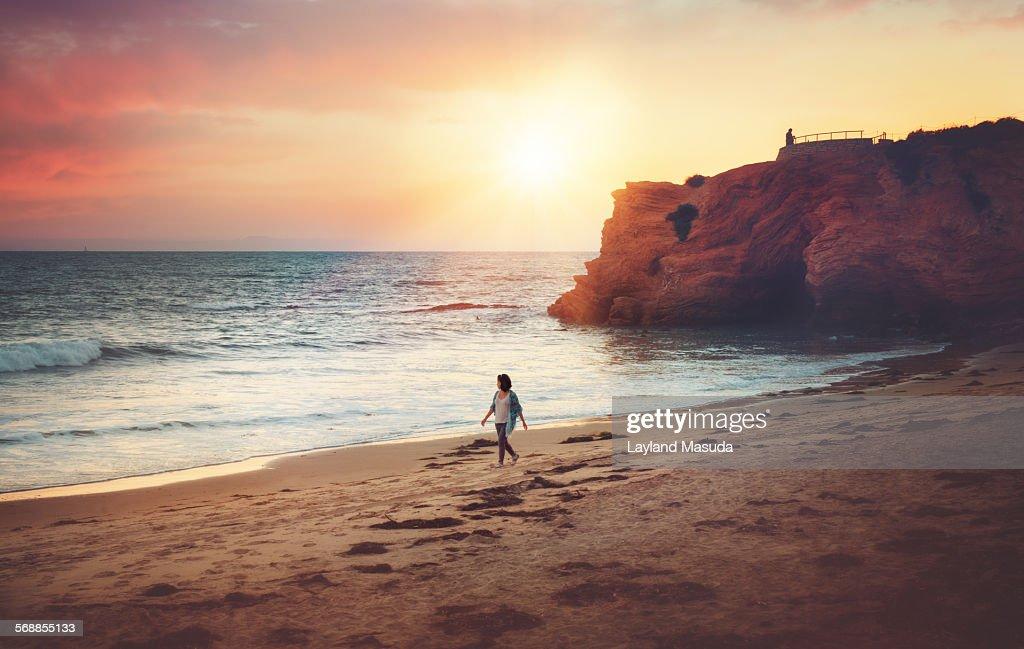 Evening Beach - Lady Walking : Stock Photo