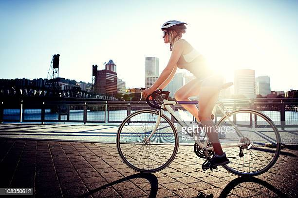 evening bike commute - cycling helmet stock photos and pictures