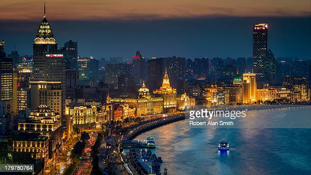 CONTENT] evening cityscape of the famous landmark buildings of Shanghai's river front called the Bund