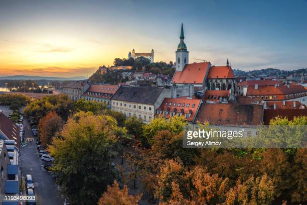evening dawn over bratislava castle and old town district - bratislava stock pictures, royalty-free photos & images