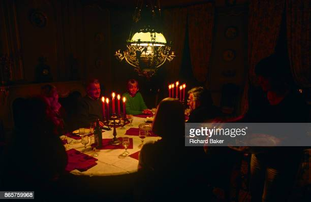 Evening dinner is served by candlelight in the Domaine de Rennebourg a gite property in southwestern rural France on 15th October 1997 in...