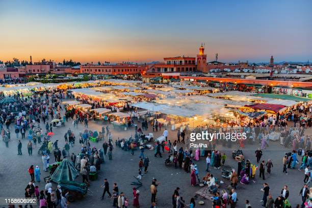 evening djemaa el fna square with koutoubia mosque, marrakech, morocco,north africa - djemma el fna square stock photos and pictures