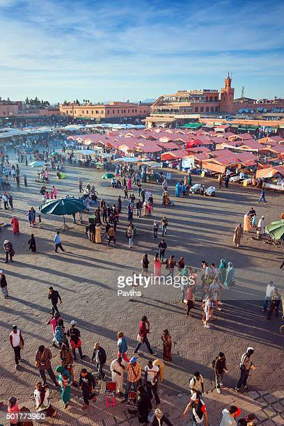 evening djemaa el fna square with koutoubia mosque, marrakech, morocco - djemma el fna square stock photos and pictures