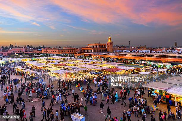evening djemaa el fna square with koutoubia mosque, marrakech, morocco - souk stock pictures, royalty-free photos & images
