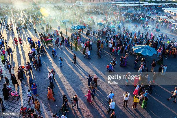 evening djemaa el fna square with koutoubia mosque, marrakech, morocco - moroccan culture stock photos and pictures