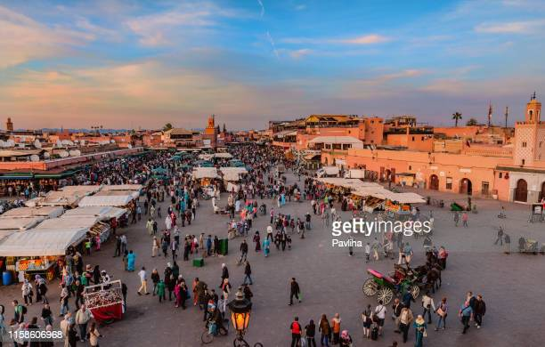evening djemaa el fna square with koutoubia mosque,marrakech, morocco,north africa - street market stock pictures, royalty-free photos & images