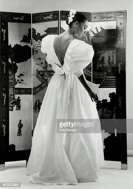 Evening drama Left ballgown in ecru silk taffeta has pleated Vneck back $1200 Hair by Rodney Black of Monroe Hair