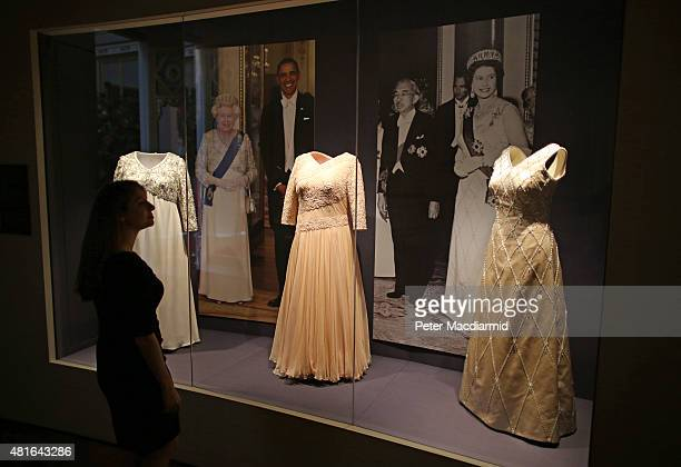Evening dresses worn by Queen Elizabeth II for state banquets are shown at The Royal Welcome exhibition Summer opening at Buckingham Palace on July...