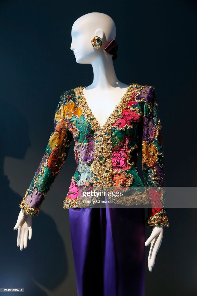 Evening ensemble consisting of a multi-coloured embroidered patchwork effect jacket and a pair of pants in satin charmeuse is displayed during the exhibition 'Hubert de Givenchy' at 'Cite de la Dentelle et de la Mode' on June 15, 2017 in Calais, France. This exhibition takes part from June 15 to December 31, 2017.