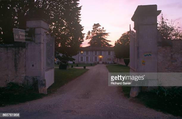 Evening exterior looking through the gates of Domaine de Rennebourg a gite property in southwestern rural France on 15th October 1997 in...