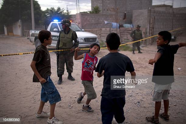 Evening falls and children play rough near the scene of the crime where a 15 year old boy was found murdered and beheaded on August 5 Ciudad Juarez...
