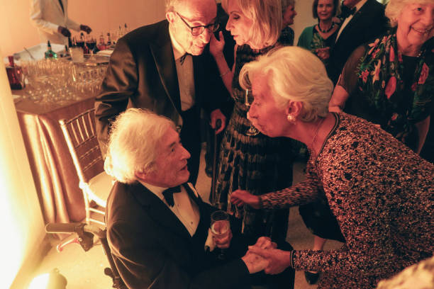 Evening gala for Christine Lagarde's departure from the IMF Christine Lagarde James Wolfensohn and Alan Greenspan are photographed for Paris Match in...