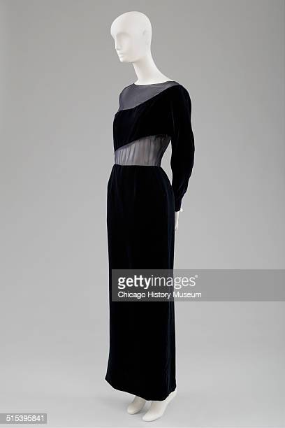 Evening gown designed by Carolyne Roehm of navy blue velvet with chiffon covered cutouts 1991 Shown as part of the Chicago History Muesum's November...