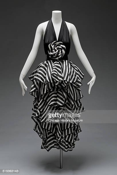 Evening gown, designed by James Galanos, with black bodice and striped ruffled skirt, 1980. Shown as part of the Chicago History Muesum's November...