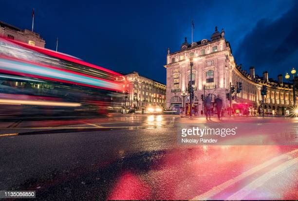 evening illumination at piccadilly circus in london city - stock image - west end london stock pictures, royalty-free photos & images