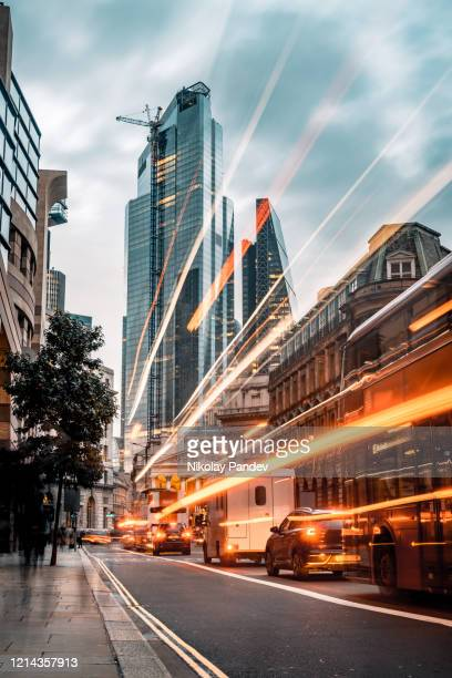 evening illumination in london city during rush hour - creative stock image - west end london stock pictures, royalty-free photos & images