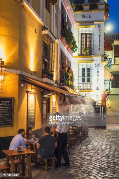 evening in santa cruz, seville - seville stock pictures, royalty-free photos & images