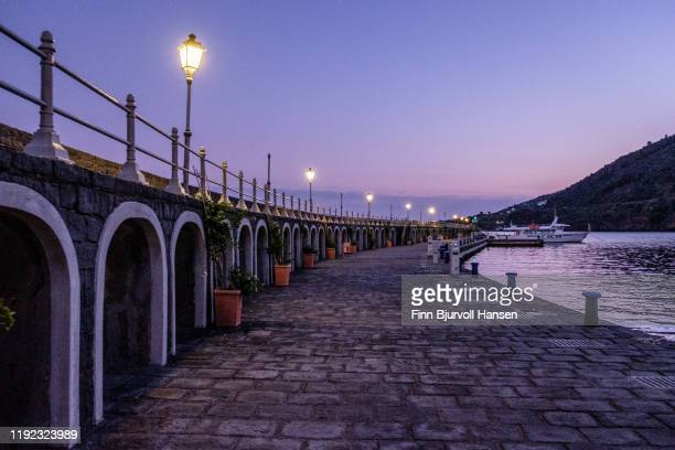 evening in the harbour marina of the aeolian island salina - finn bjurvoll stock pictures, royalty-free photos & images