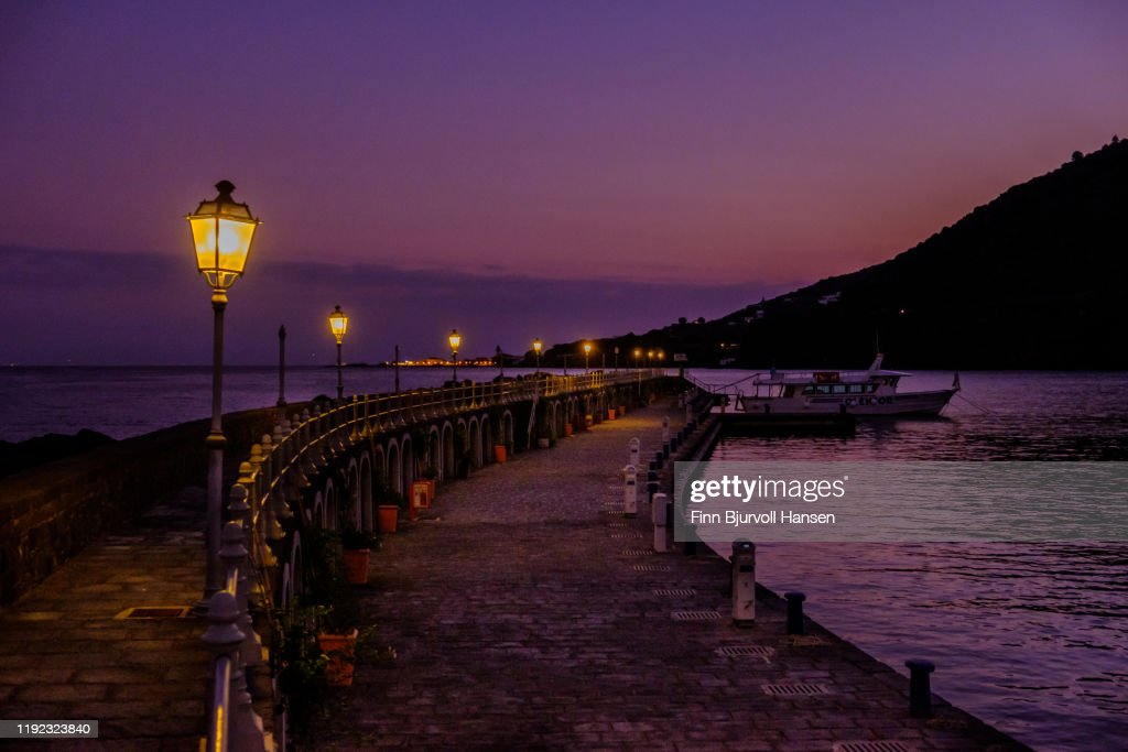 Evening in the harbour of the aeolian island of Salina : Stock Photo